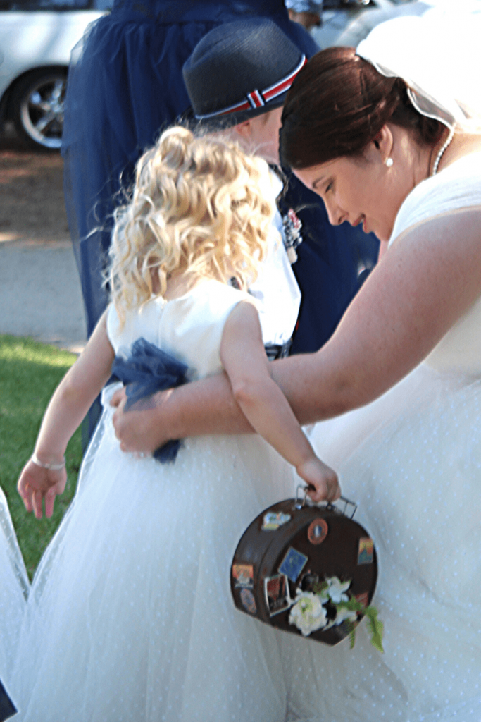 Pep talk for my flower girl: our navy and red vintage travel themed wedding. Photo Kate Basso Photography