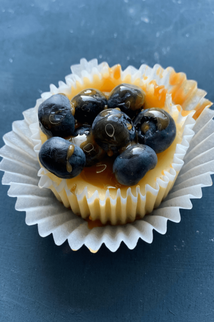 Mini stroopwafel cheesecake topped with caramel sauce and blueberries