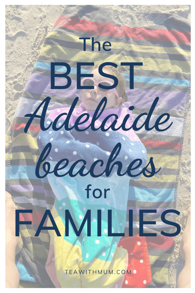 The best Adelaide beaches for families: Recommendations from the locals; image of child wrapped in rainbow-colored towels