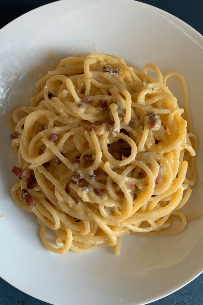 Fresh bowl of traditional spaghetti carbonara made using an Italian recipe