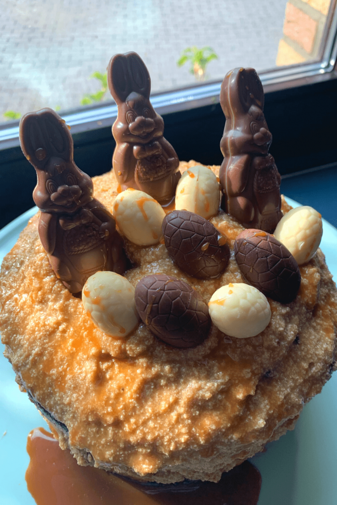 Naked chocolate carrot cake, with up close view of the decorations (little chocolate bunnies and milk and white Easter eggs) chosen by my apprentice chef