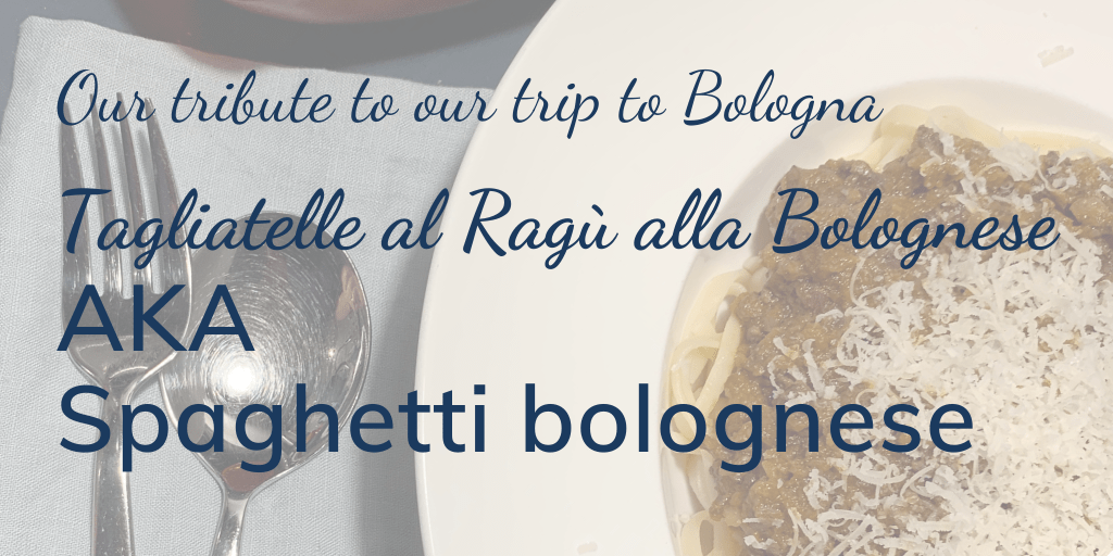 Our tribute to our trip to Bologna: Tagliatelle al ragù alla Bolognese, AKA spaghetti Bolognese; banner; image of large bowl of traditional spaghetti bolognese with parmesan cheese