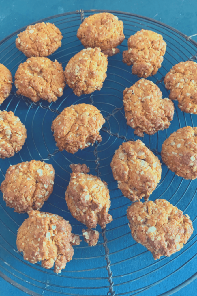 Fresh Anzac biscuits on a cooling rack