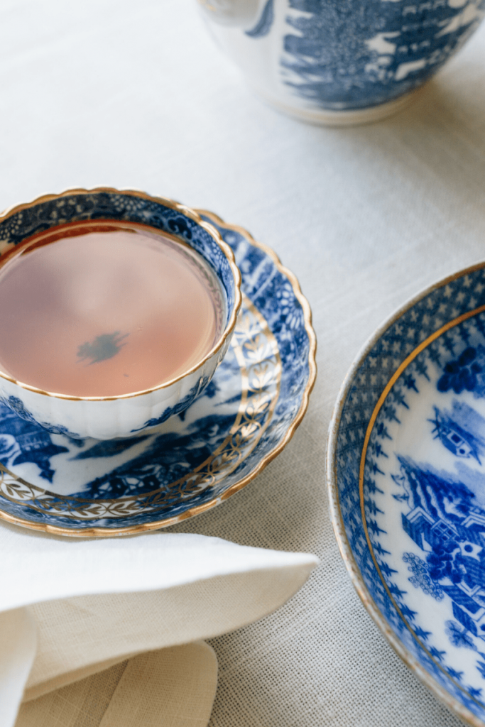 Treat yourself to afternoon tea, with the good china and cloth napkins; image of cup of tea and plate and cloth napkin by Erol Ahmed on Unsplash