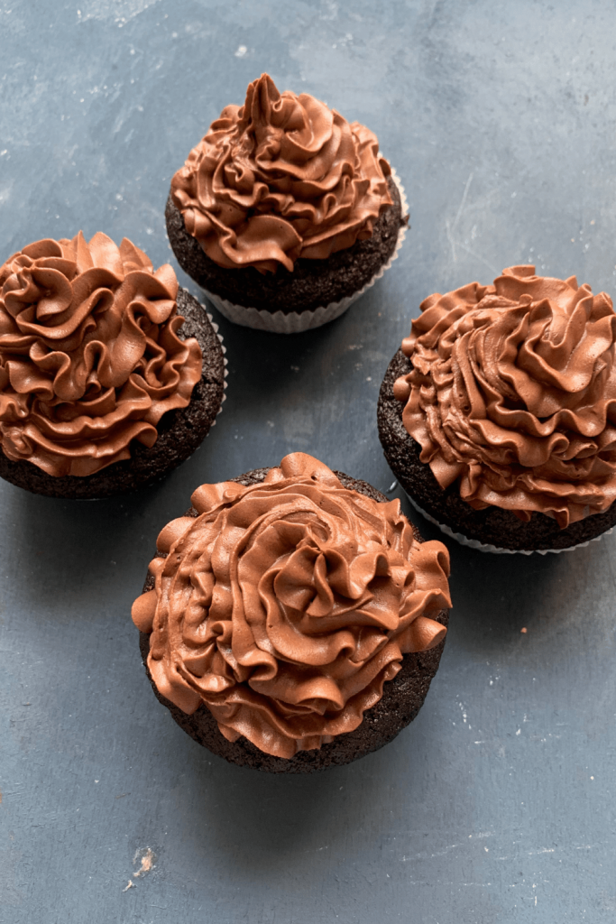Four Depression Era chocolate cupcakes with rich chocolate frosting