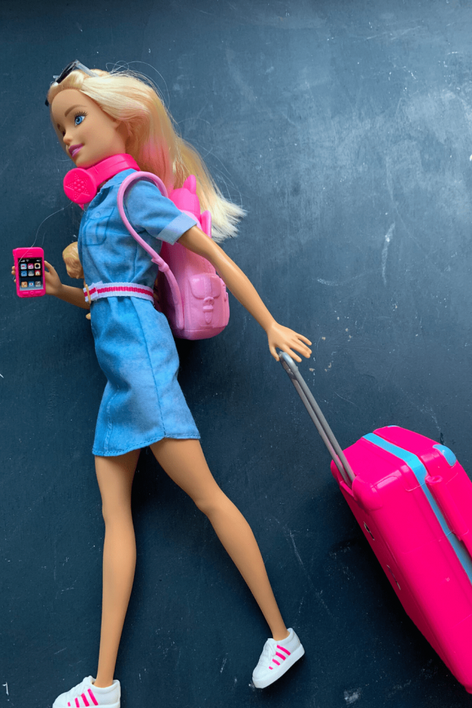 What can Barbie teach you about packing your hand luggage? Barbie likes to flit about the airport, all stylish in pink.