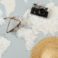 Three more things you should know about me: My bucket list does not fit on one page - image of a map with a camera, sunglasses and hat