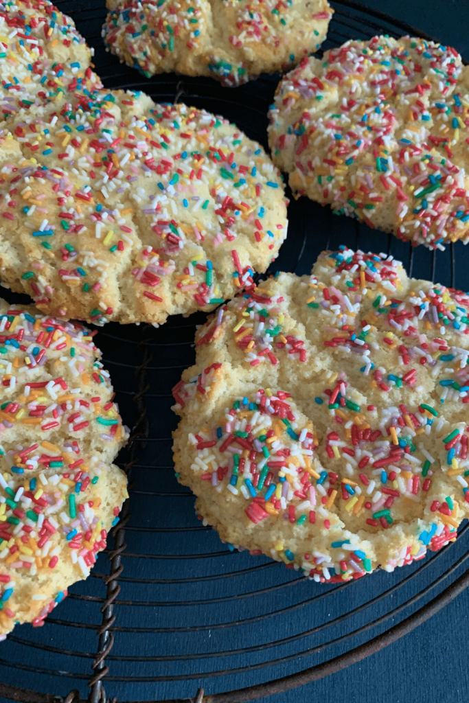 A rack of cooling delicious and fun sprinkle cookies
