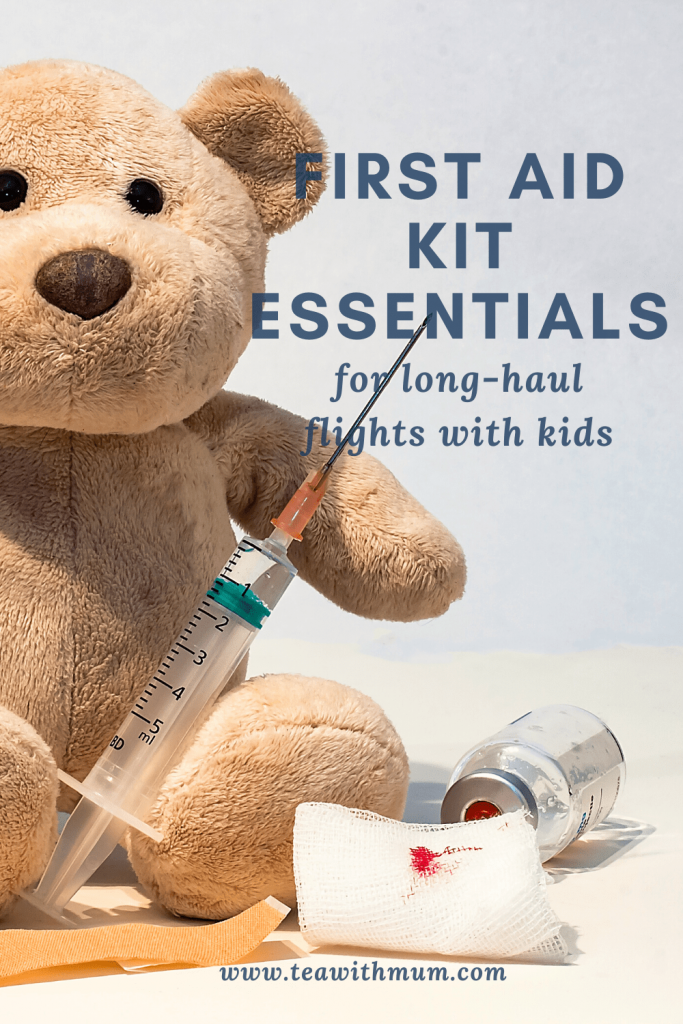 The essential first aid kit for long-haul flights with kids; image of a bear with a needle and medical supplies