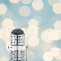 Three more things about me: I love live music. Image of a microphone