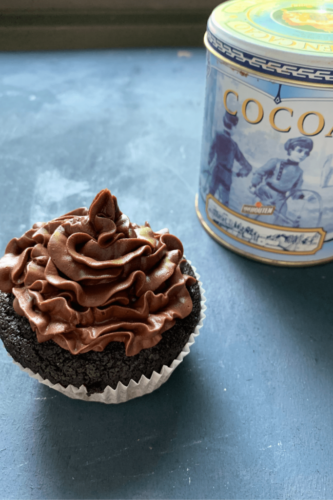 Depression Era chocolate cupcake with a vintage Van Houtens cocoa tin