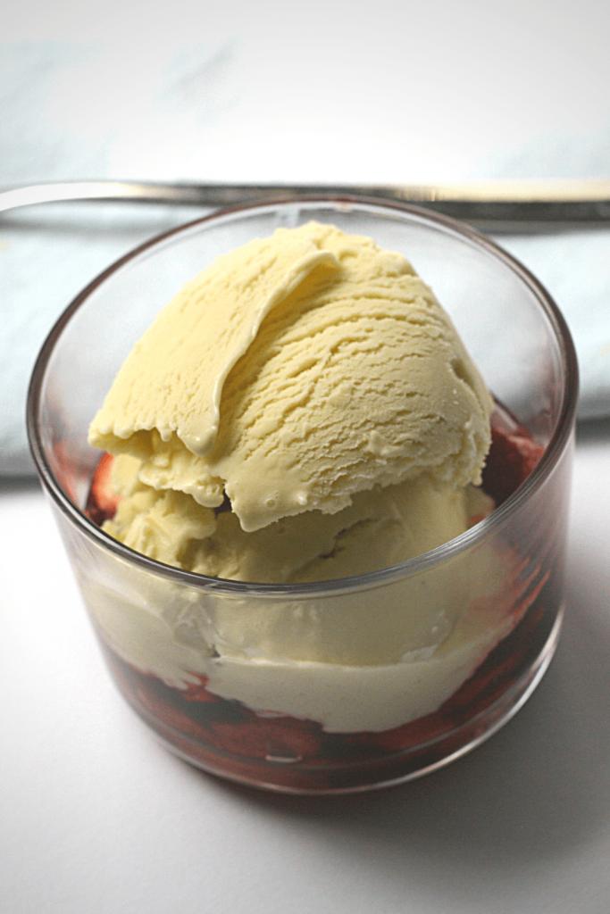 dish of basil ice cream with warm caramelised balsamic strawberries