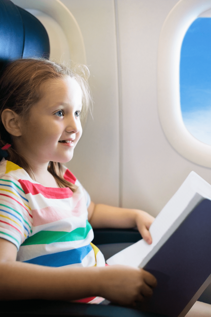 What to do if your flight is delayed when you are travelling with young children. Distract them with a book.