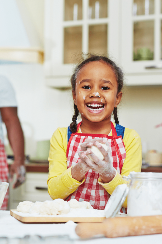 Little girl baking - a great way to prepare your kids for your next trip