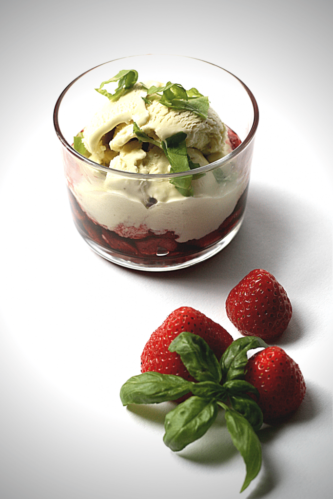 Dish of basil ice cream with balsamic strawberries