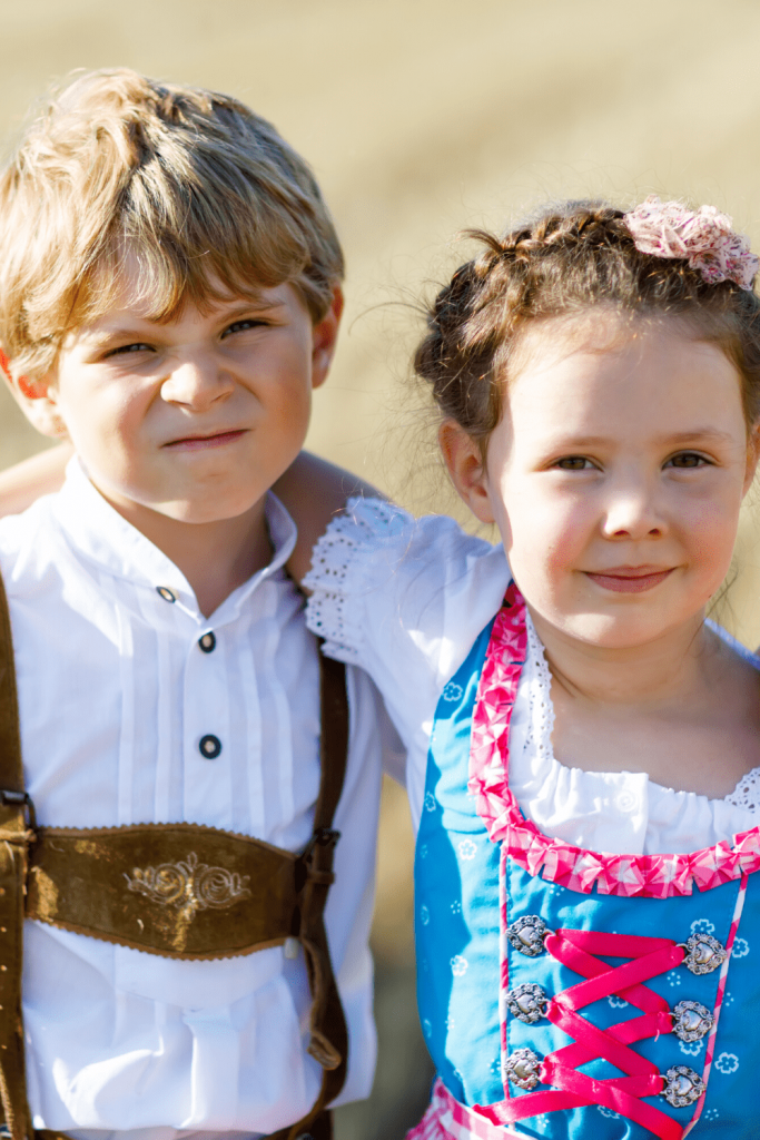 Two children in traditional German 'Tracht' (Dirndl and Lederhosen)