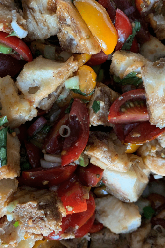 Close up of the bread, tomatoes and onions in our panzanella recipe