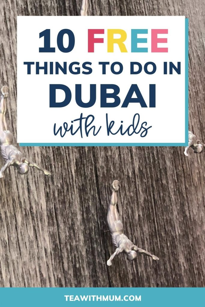 10 free things to do in Dubai with kids: pin with image of fountain with divers at Dubai Mall
