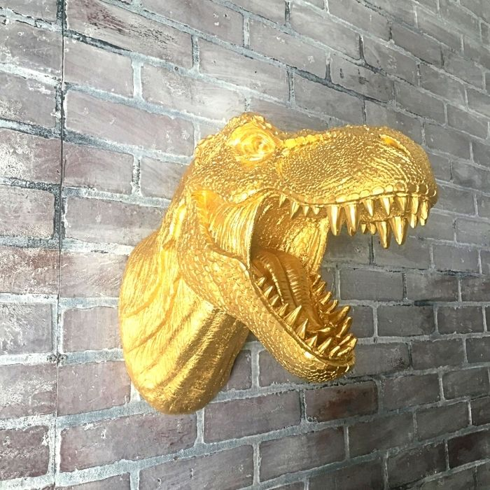50+ dinosaur gifts for girls: faux taxidermy, here a more realistic gold T-Rex head