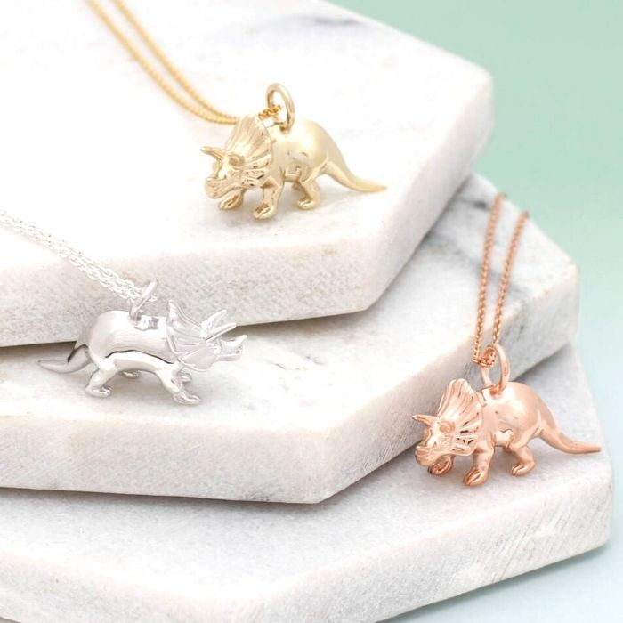 50+ cool dinosaur gifts for girls who love dinosaurs: This triceratops necklace is our daughter's favourite