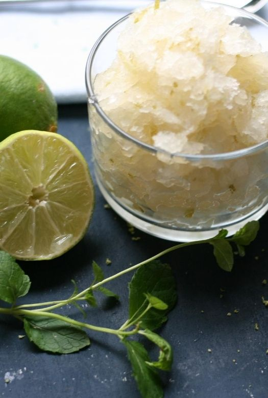 Delicious and simple caipirinha sorbet with limes and mint on the side