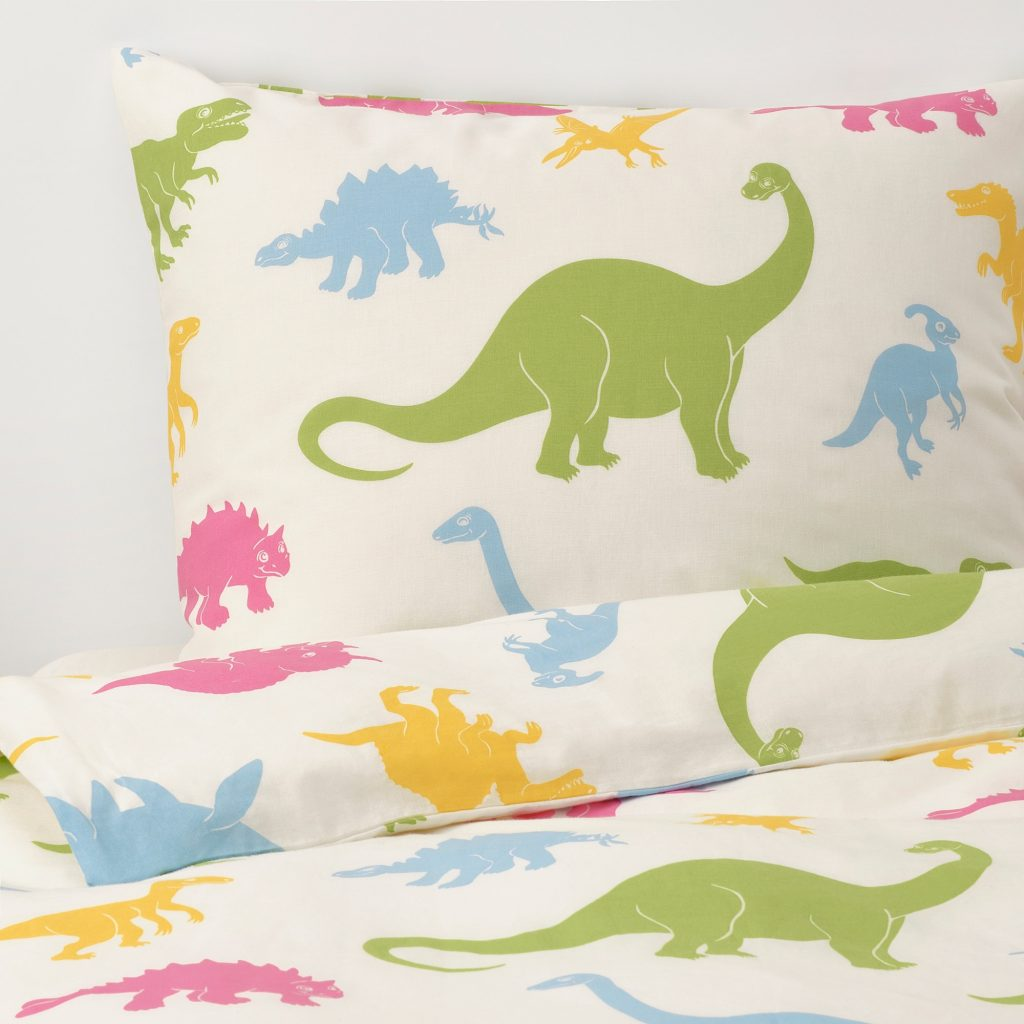 50+ cool dinosaur gifts for girls who love dinosaurs: IKEA has gotten in on the act with some new bedding. Here the Jättelik duvet cover and pillowcase in green, yellow, blue and pink! Image: ikea.com