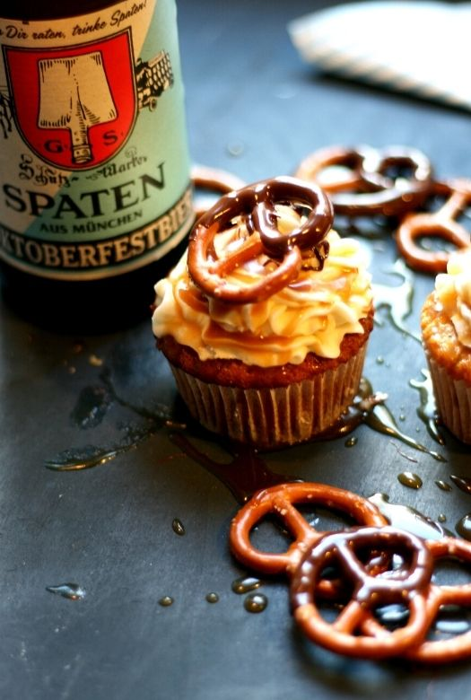 Oktoberfest cupcakes, with pretzels and bottle of Oktoberfest beer