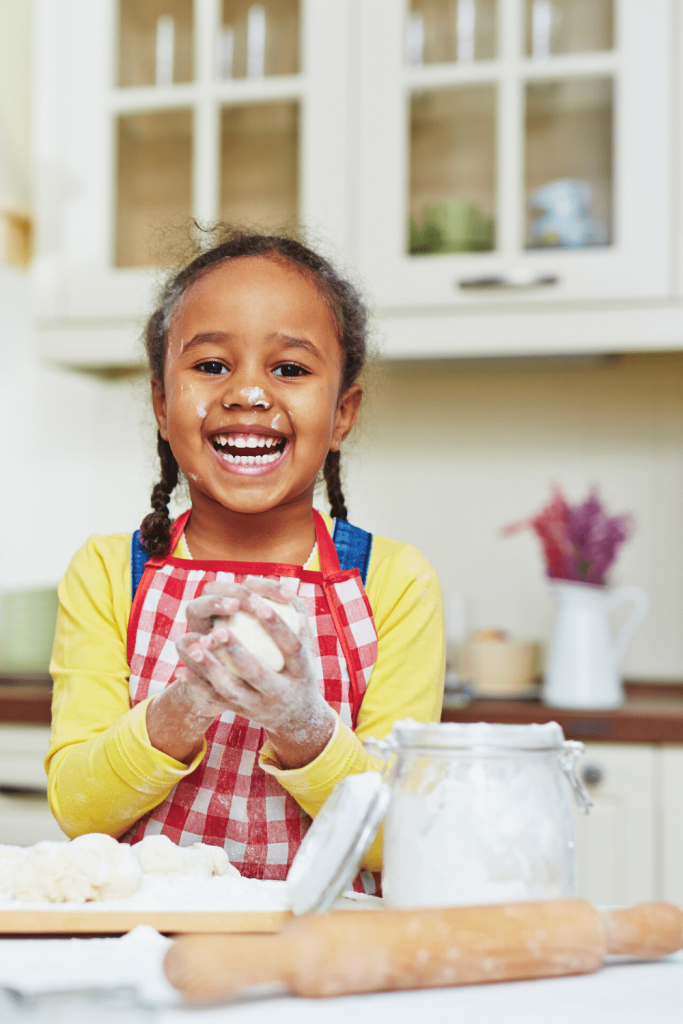12 top tips for baking with kids and why you should: Image of young girl baking