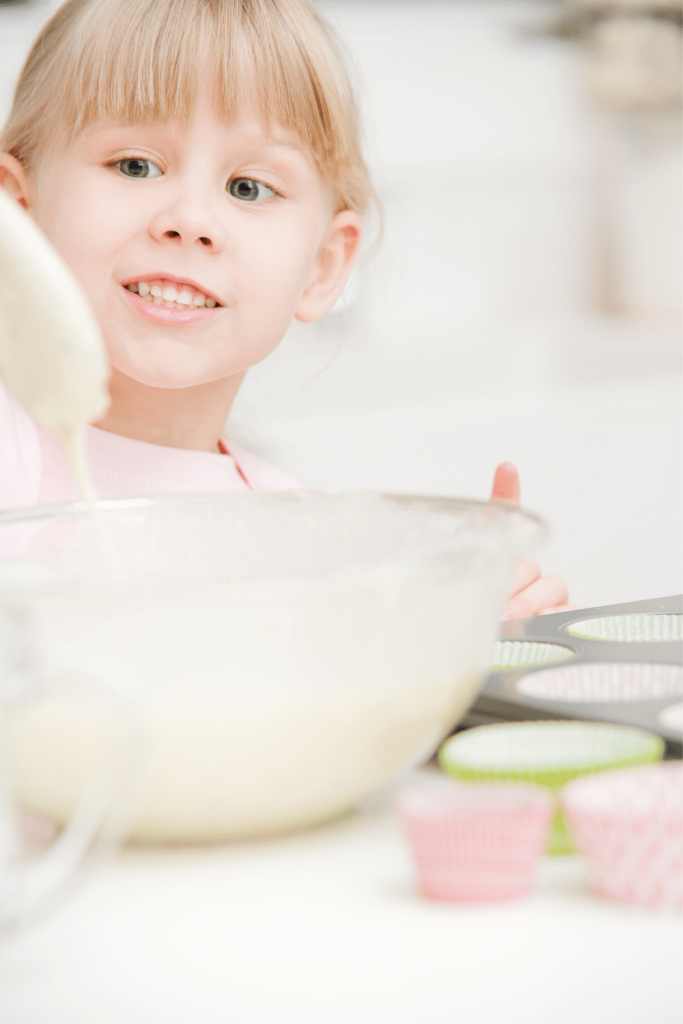 Top tips for baking with kids: child checking batter