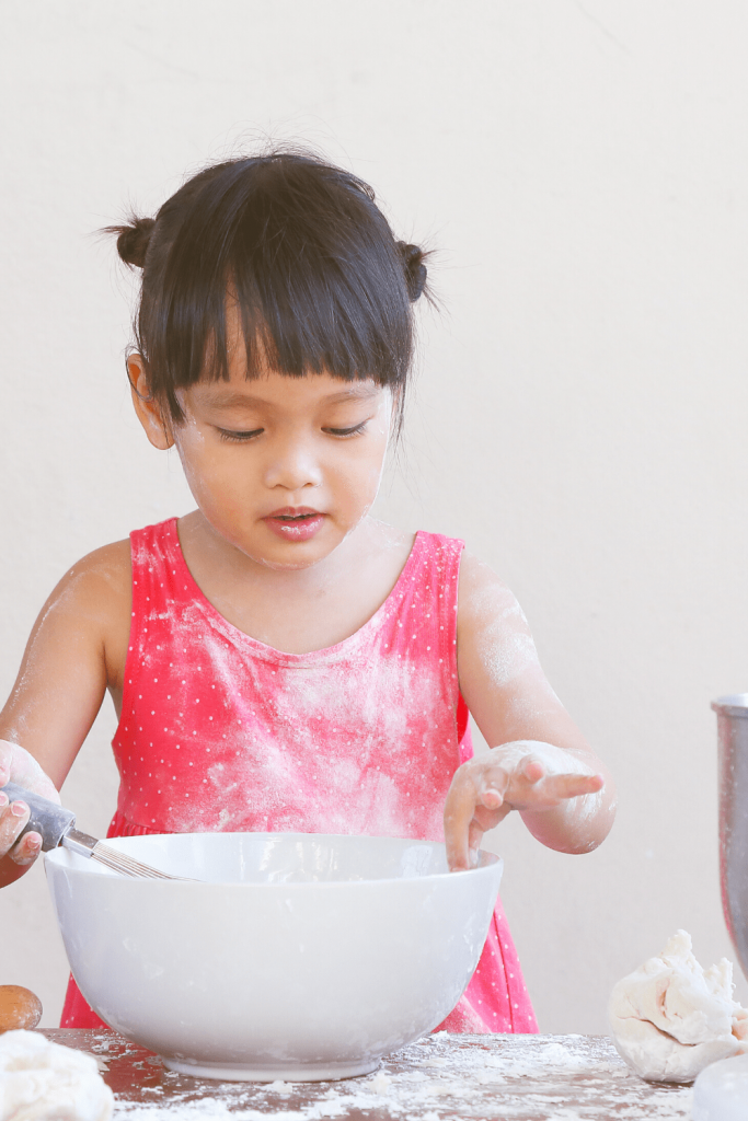 Top tips for baking with kids: child with flour everywhere