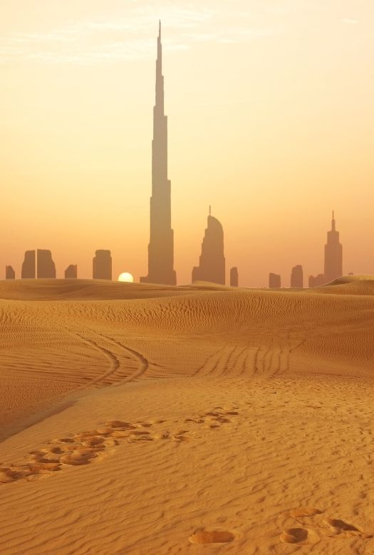 Everything you need to know before visiting Dubai with kids:  The Dubai skyline from the desert