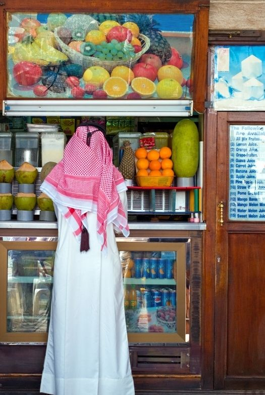 Everything you need to know before visiting Dubai with kids: don't take photos of strangers without asking permission (here a photo of an Emirati man at a juice bar - not my photo).