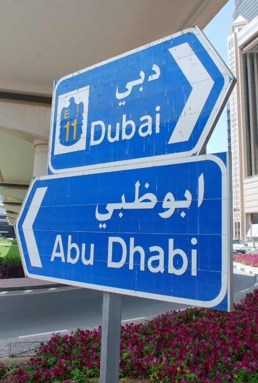 18 things you need to know before you go to Dubai - signs are in Arabic and English (image of road signs in both languages)