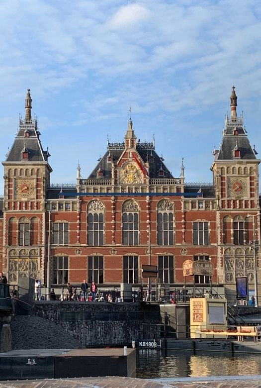 The ultimate 2020 gift guide: great gifts for travel lovers when they can't travel. Why not get them a rail pass for their European trip? They're sure to want to go to Amsterdam (and visit via the Amsterdam Station - pictured)