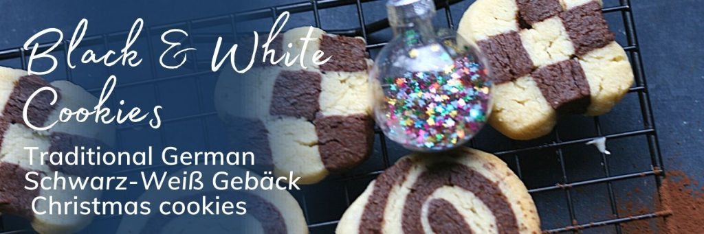 Black and white Christmas cookies - banner with image of the cookies in checkerboard and swirl patterns and a Christmas bauble