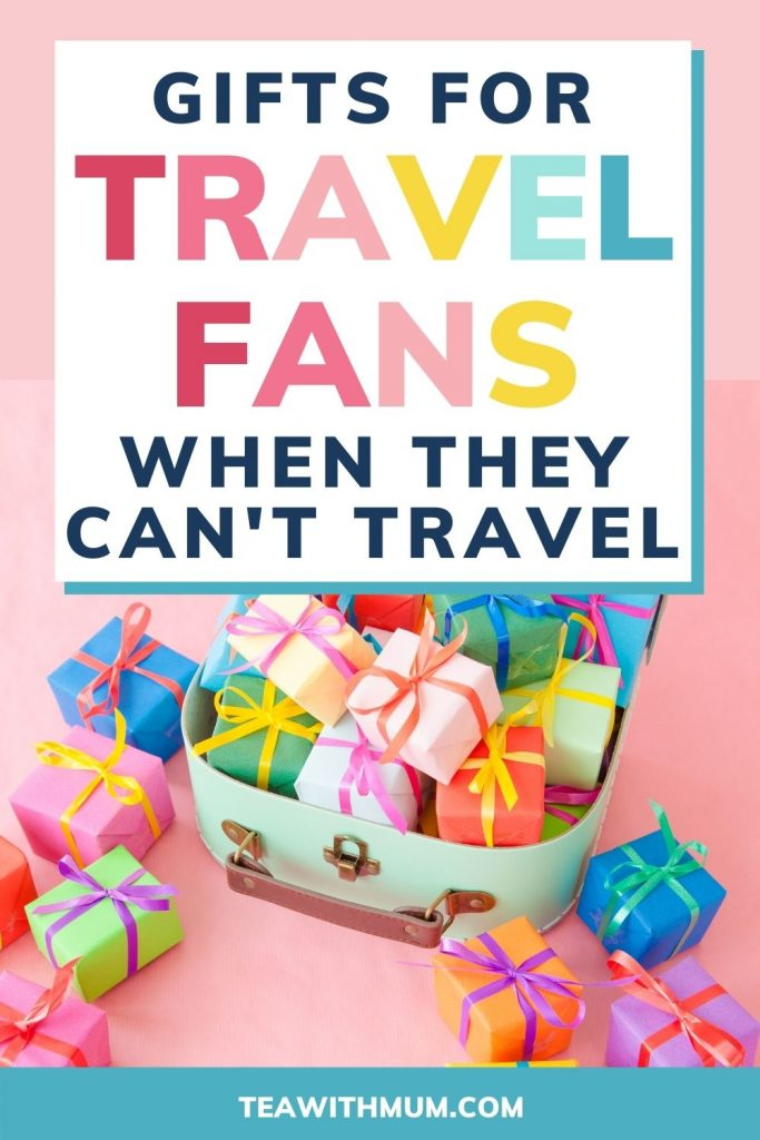 PIN: Gifts for travel fans when they can't travel - with image of brightly wrapped gifts in a suitcase