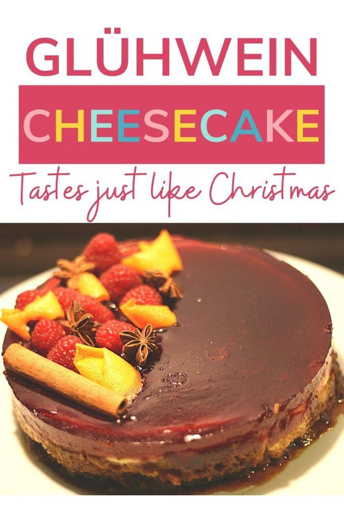 PIN: Glühwein cheesecake: Tastes just like Christmas; with close up image of Glühwein cheesecake topped with orange peel, raspberries, cinnamon sticks and star anise
