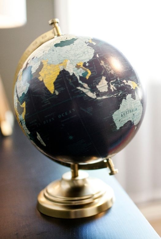 Great gifts for travel lovers when they can't travel , like a stylish globe to help plan their next trip
