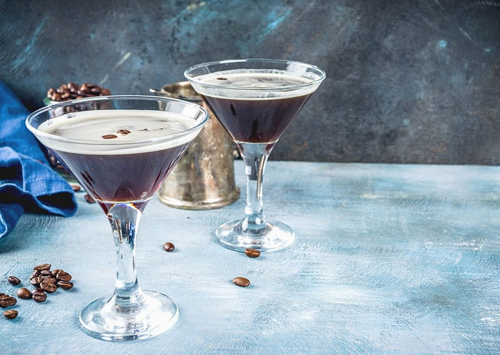 An espresso martini (pictured) or vodka espresso go wonderfully with these easy mocha cupcakes with mocha frosting