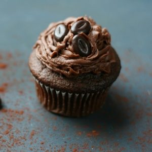 Easy mocha cupcake with mocha frosting and chocolate-covered coffee beans