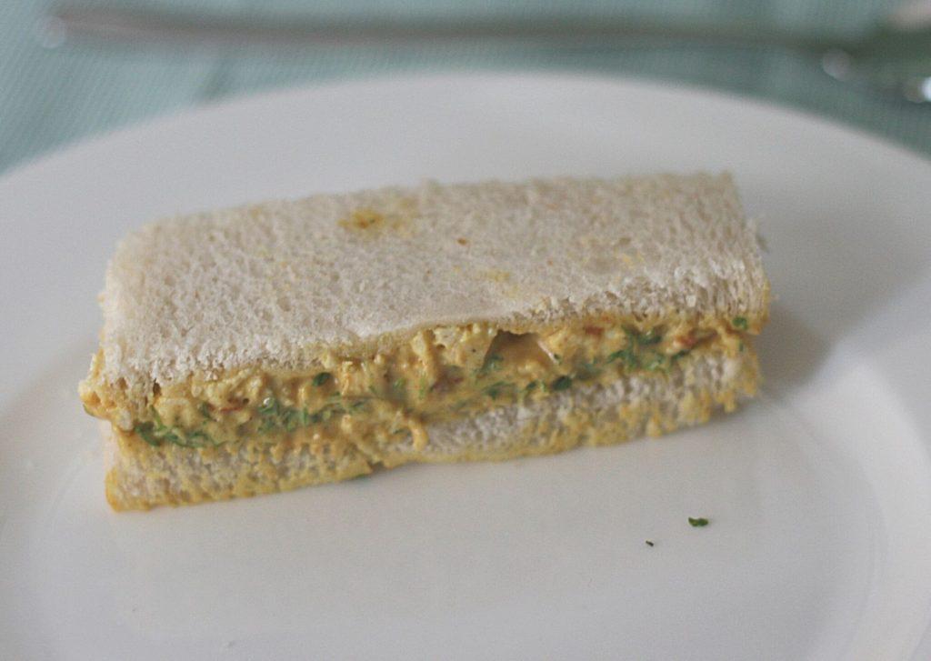 Coronation chicken afternoon tea finger sandwich, on white bread
