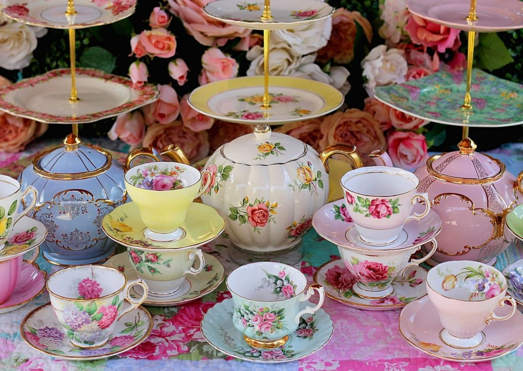 You can go as fancy as you like with your table settings for Afternoon Tea. Decorative floral fine china tea pots and tea cups.