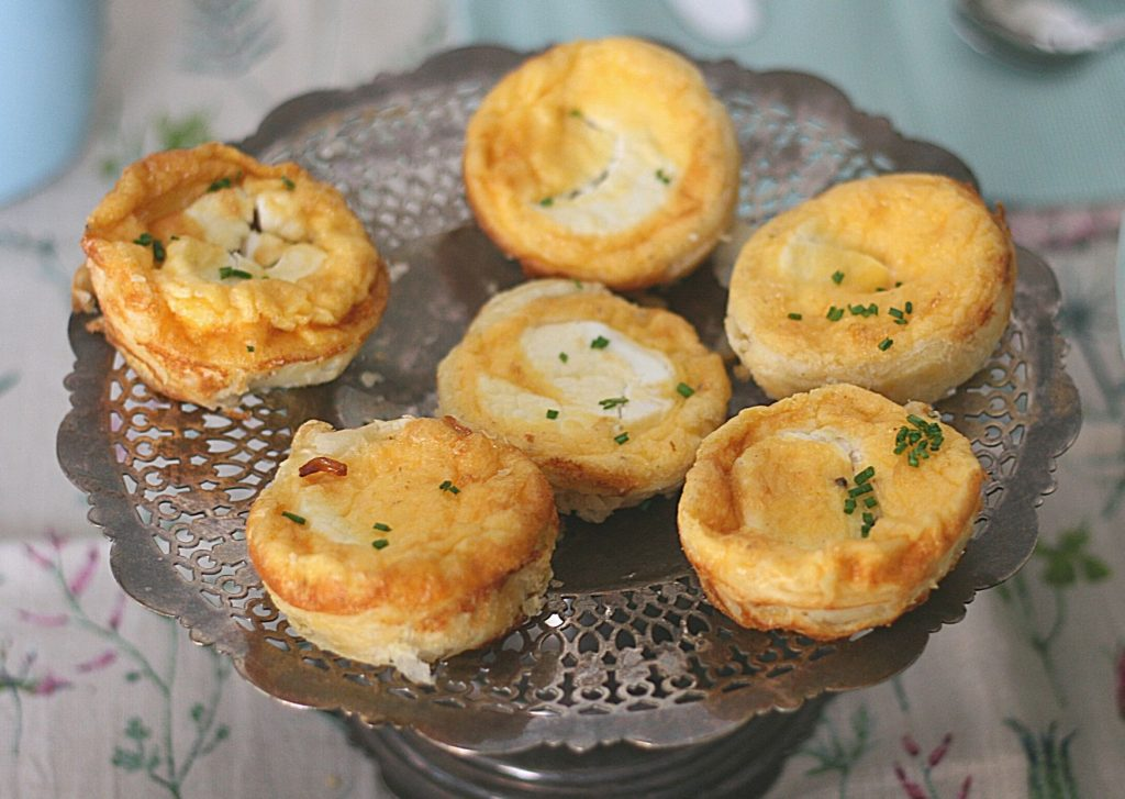 Goat's cheese and caramelised onion tarts on an antique silver tray