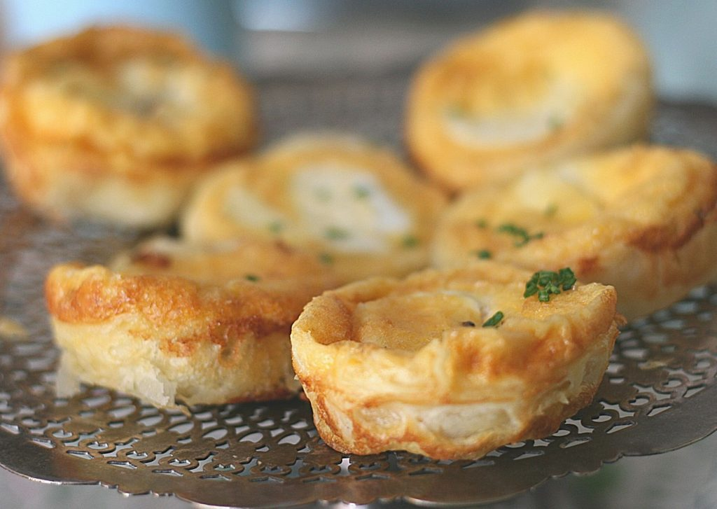 6 easy and elegant goat's cheese and caramelised onion tarts on an antique silver cake stand