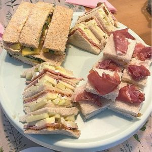 3 of our 5 afternoon tea sandwiches with a fruity twist: ham, mustard, brie and apple; grilled chicken, mango and sweet chili; mascarpone, fig compote and prosciutto