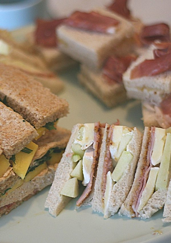Afternoon tea sandwiches with a fruity twist: ham, mustard, brie and apple; mascarpone, fig compote and prosciutto; grilled chicken, mango and sweet chili