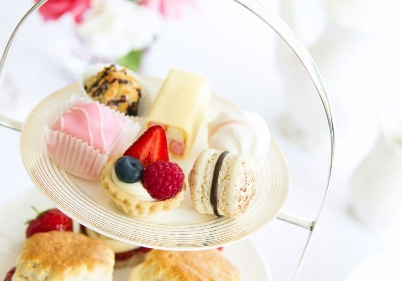 Afternoon tea recipes - cake stand with petit fours and scones for afternoon tea