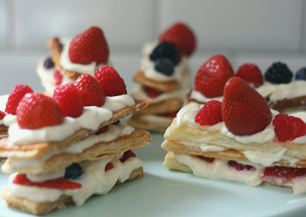 Mille-feuille with white chocolate mascarpone and fresh berries on a mint cake stand