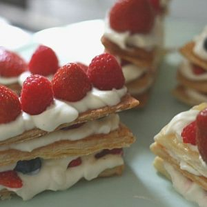 Delicious Mille-feuille with white chocolate mascarpone cream and fresh berries